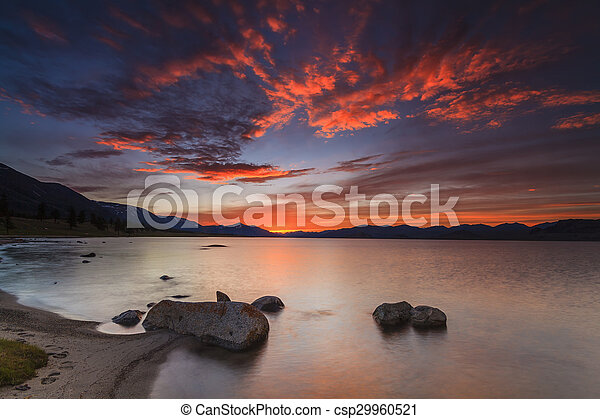 Amazing red sunset over a mountain lake. - csp29960521