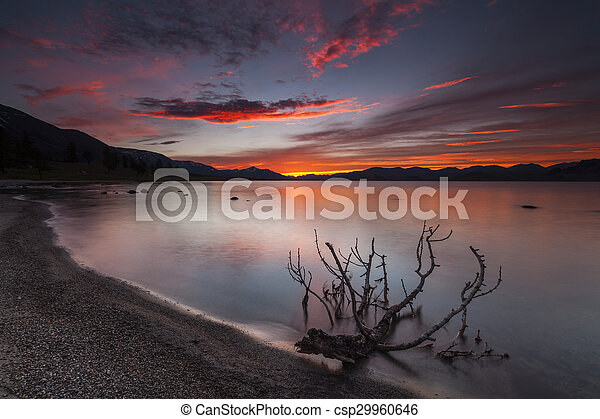 Amazing red sunset over a mountain lake. - csp29960646