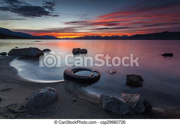 Amazing red sunset over a mountain lake. - csp29960726