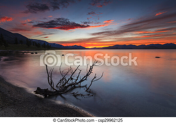 Amazing red sunset over a mountain lake. - csp29962125