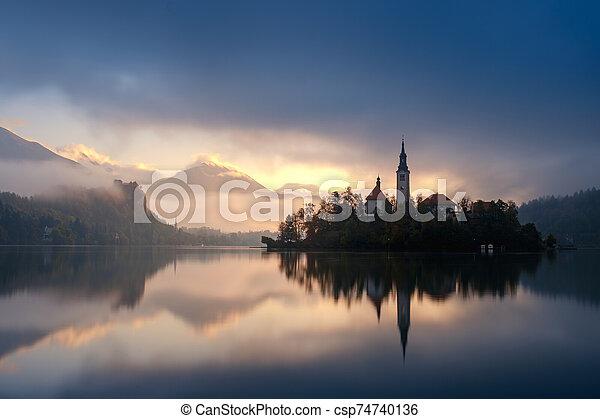 Amazing sunrise at the lake Bled in autumn, Slovenia, Europe - csp74740136