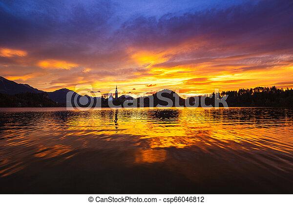 Amazing sunrise at the lake Bled - csp66046812