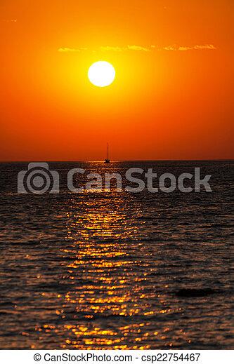 Amazing sunset over blue sea - csp22754467