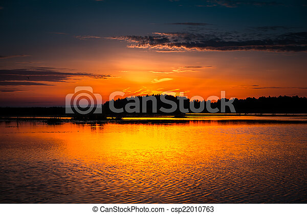 Amazing sunset over lake - csp22010763
