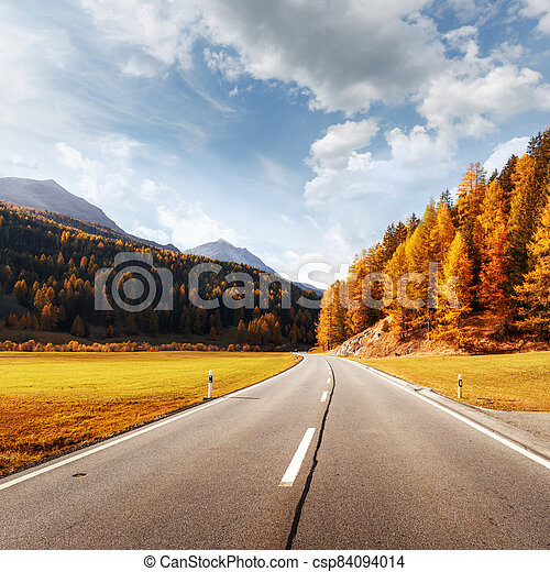 Amazing view of alpine road, orange larch forest and high mountains - csp84094014