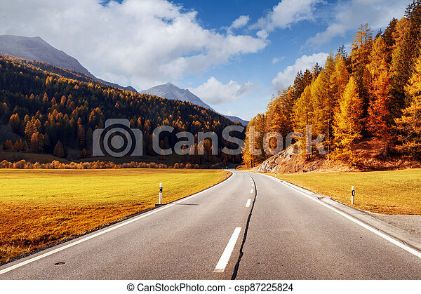Amazing view of alpine road, orange larch forest and high mountains - csp87225824