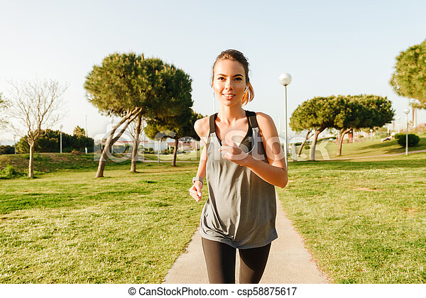 Amazing young sports woman running - csp58875617