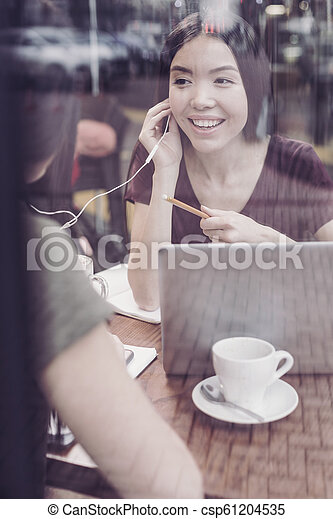 Amazing young woman sitting opposite her partner - csp61204535