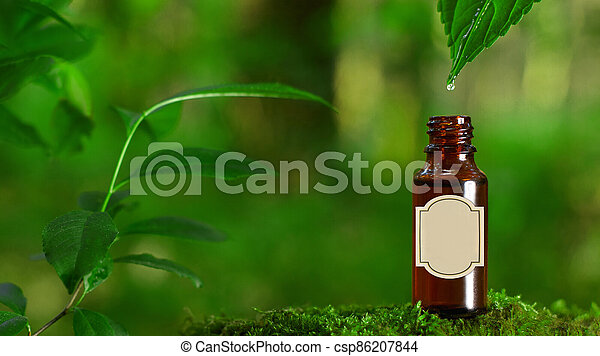 Amber glass bottles and a leaf with a drop of water. MOCK-UP CONCEPT - csp86207844