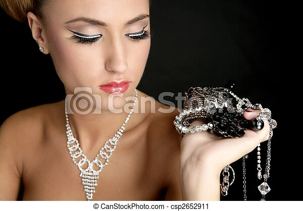 Ambition and greed in fashion woman with jewelry - csp2652911