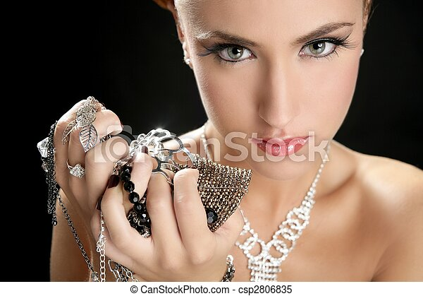 Ambition and greed in fashion woman with jewelry - csp2806835