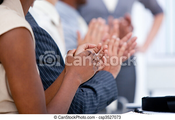 Ambitious business team applauding in a meeting - csp3527073