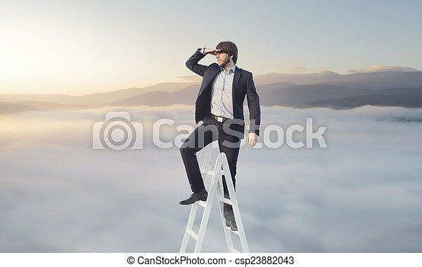 Ambitious businessman looking for his target - csp23882043