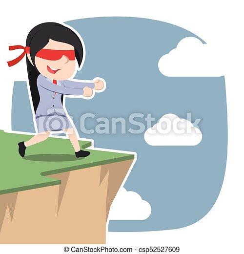 Mujer de negocios asiática con los ojos vendados caminando al borde del acantilado - csp52527609