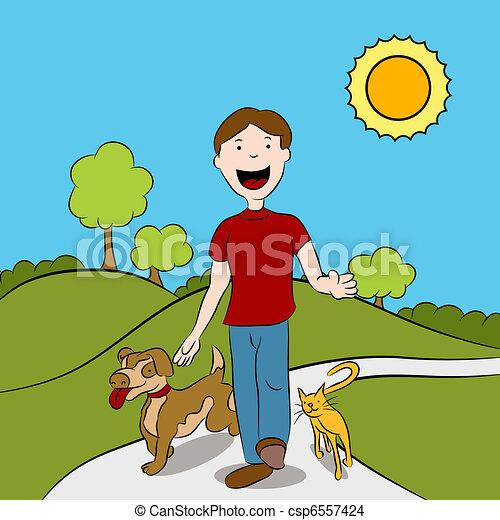 Un hombre caminando con sus mascotas en el parque - csp6557424