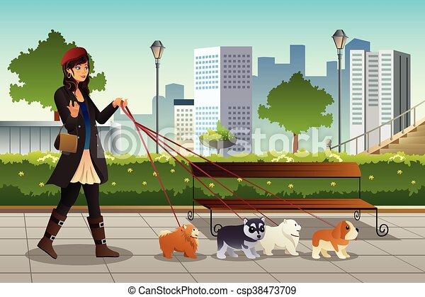 Mujer caminando con sus perros - csp38473709