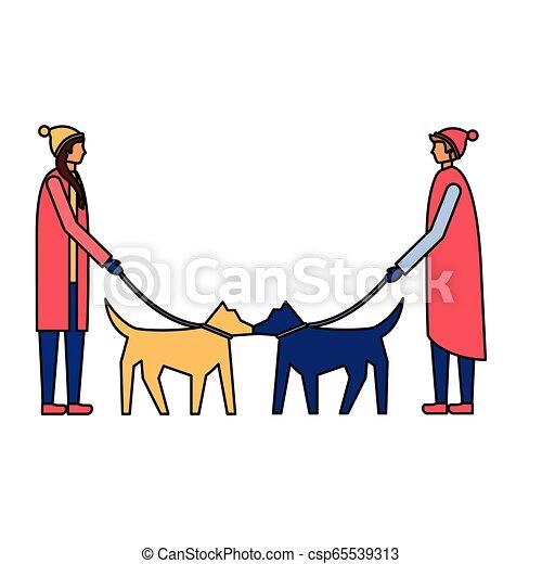 Hombre y mujer paseando a sus perros - csp65539313