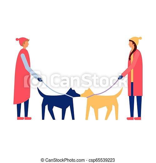 Hombre y mujer paseando a sus perros - csp65539223