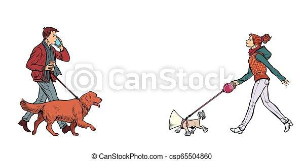 Hombre y mujer caminando con perros - csp65504860