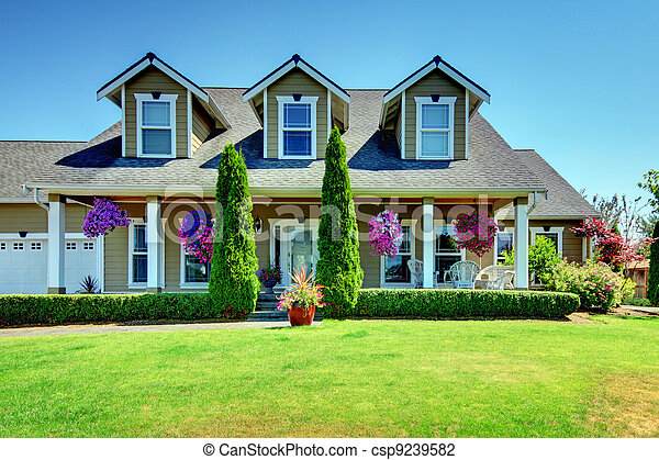 American Country farm luxury house with porch. - csp9239582
