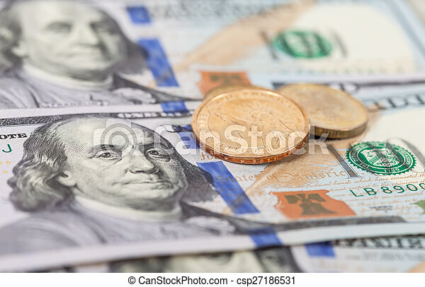 American dollar coins over banknotes close up - csp27186531