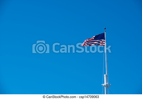 American Flag against a blue sky - csp14709063