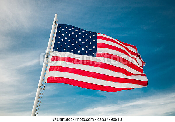 American flag against bright blue sky - csp37798910