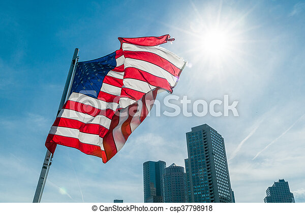 American flag against bright blue sky - csp37798918