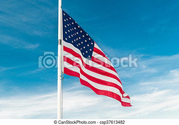 American flag against bright blue sky - csp37613482