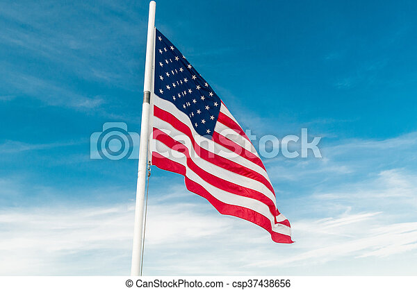American flag against bright blue sky - csp37438656