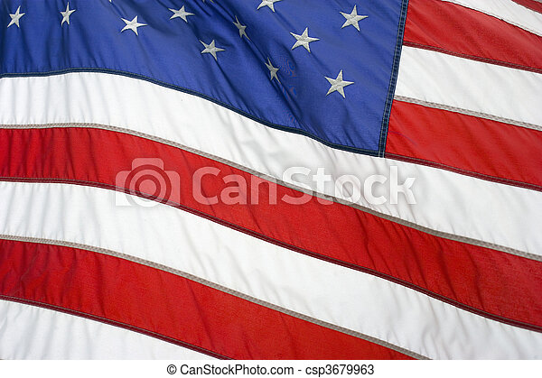 American flag flying proudly on a windy day - csp3679963