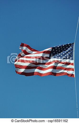American flag in a blue sky - csp16591162