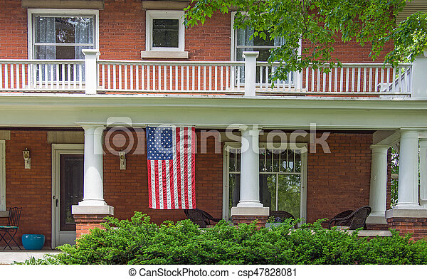 American flag on house porch - csp47828081
