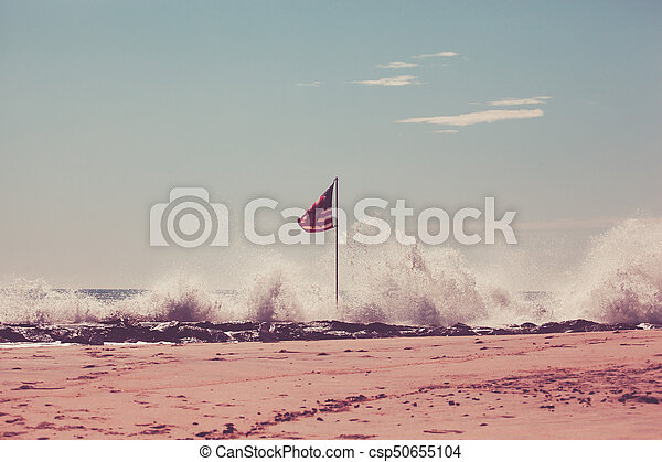 American Flag on Jetty - csp50655104