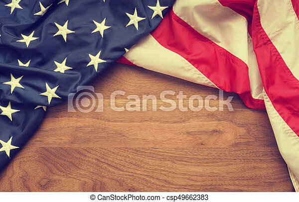 American flag on walnut wood - csp49662383