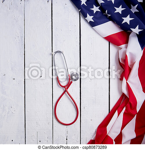 American Flag With Stethoscope On Table - csp80873289