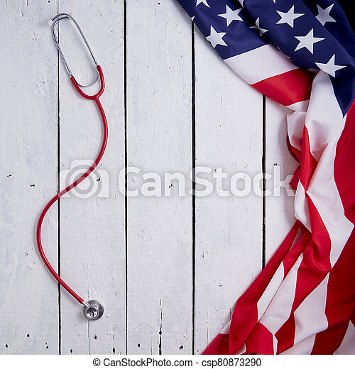 American Flag With Stethoscope On Table - csp80873290
