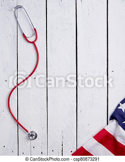 American Flag With Stethoscope On Table - csp80873291