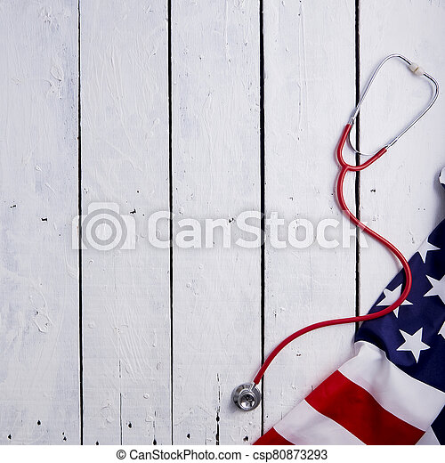 American Flag With Stethoscope On Table - csp80873293