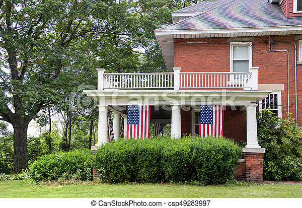 American flags in old house - csp49283997