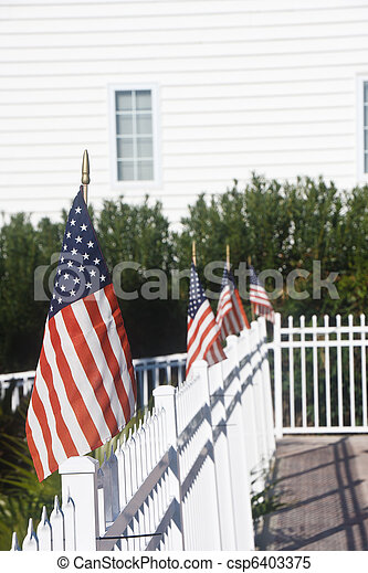 American Flags on White Picket Fence - csp6403375
