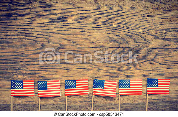 American flags on wood - csp58543471