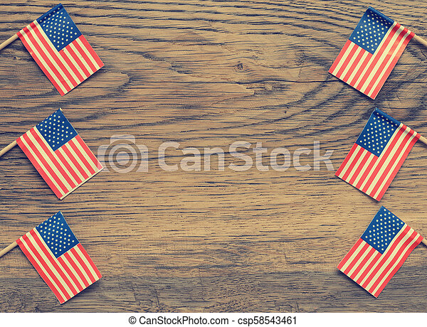 American flags on wood - csp58543461