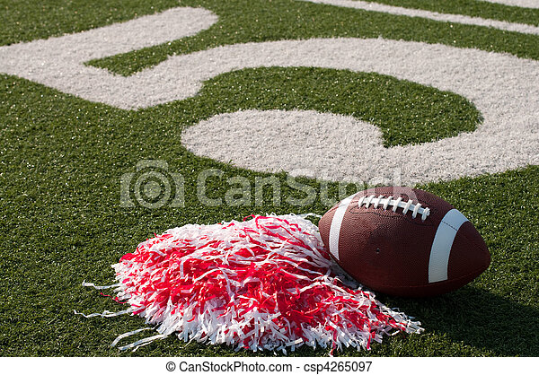 American Football and Pom Poms on Field - csp4265097