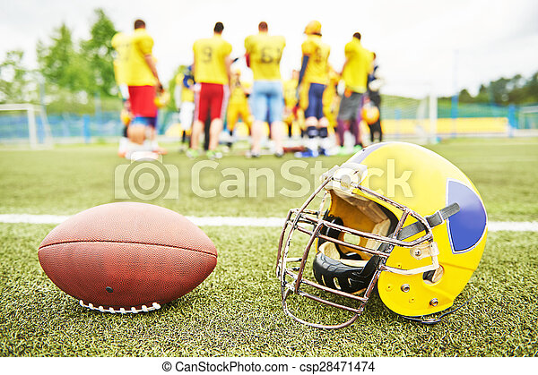 American football eqipment on grass - csp28471474
