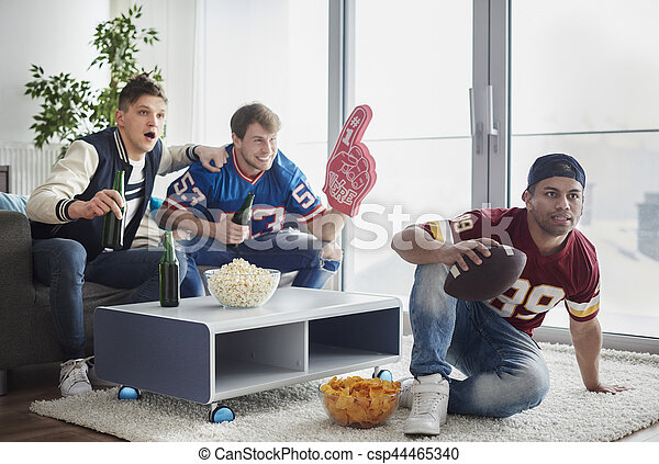 American football fans in front of tv - csp44465340