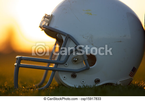 American Football Helmet on Field - csp15917833