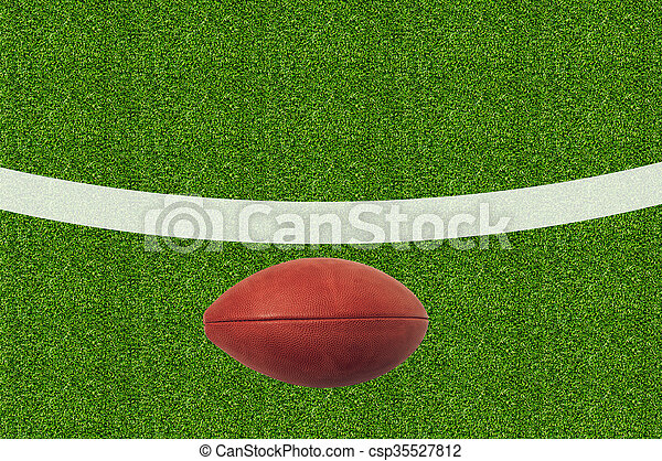 American football on green grass - csp35527812