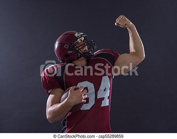 american football player celebrating touchdown - csp55289859
