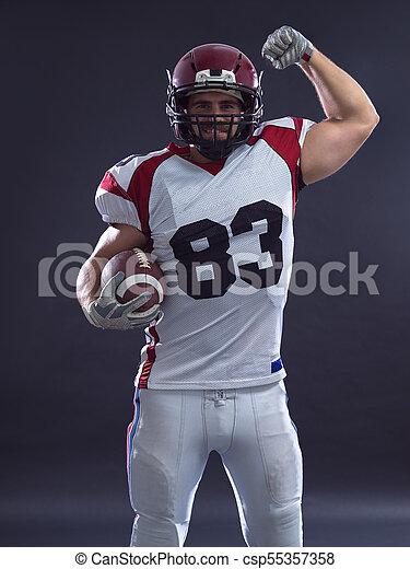 american football player celebrating touchdown - csp55357358